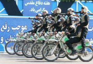 LEADERS OUT OF SYNC WITH PUBLIC -- The economy is Iran's top priority, not Palestine. Furthermore, the youth in Iran and Israel are looking for a better future and do not support the drumbeats of war. Photo shows Iranian soldiers carrying RPG-7s on motorbikes during a military parade in Tehran last month. (Photo via Newscom)